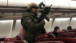 Bomb threat squad on aeroplane