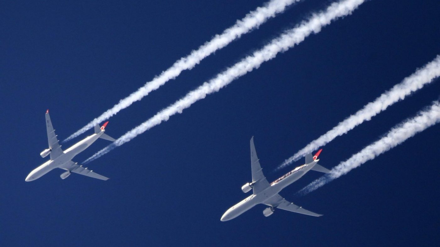 Two aeroplanes flying next to eachother